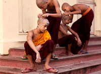 Young monks shaving
